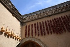Ornaments of ladle and pepper hang in the sunken courtyard Stock Photography