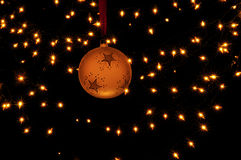 Ornaments and lights. An ornament with stars hanging in front of bright lights Royalty Free Stock Image