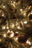 Ornaments and lights on Christmas tree Stock Photo