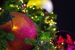 Ornaments and lights on a Christmas Tree. Tinsel and toys, balls. And other decorations on the Christmas Royalty Free Stock Images