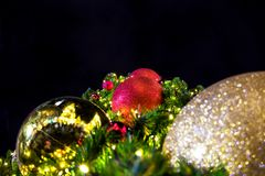 Ornaments and lights on a Christmas Tree. Tinsel and toys, balls. And other decorations on the Christmas Royalty Free Stock Photography