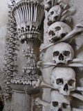 Ornaments and ornament of human bones and skulls on the site of a medieval cemetery, Kutna Hora, Czech Republic. Unusual use instead of destruction. Disregard royalty free stock photo