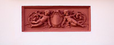 Ornaments with putti on a historic house from 1888 in Greifswald, Germany Royalty Free Stock Photo