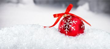 Ornaments. Red white ball holiday snow closeup Stock Photography