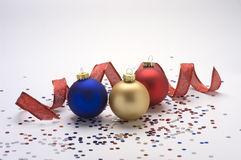 Ornaments with ribbon and confetti Royalty Free Stock Image