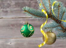 Ornaments and ribbon hanging on Blue Spruce Tree Branch Stock Photography