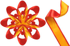 Ornaments from a satiny band. This bow is made of a satiny red and yellow band Stock Image
