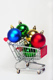 Ornaments in shopping cart. Colorful ornaments in a shopping cart Stock Image