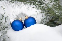 Ornaments on snowy tree Stock Image