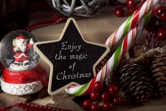 Ornaments and text enjoy the magic of christmas stock image