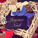 Ornaments and text joyeux noel, merry christmas in french Stock Photography