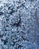 Ornaments on the window created by frost 2. Ornaments on the window created by frost. Frozen water on the window creates silver beautiful odecoration ornaments Stock Photos