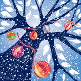 Ornaments in Winter. Tree with holiday ornaments under falling snow, sky blue background,  illustration Royalty Free Stock Photography