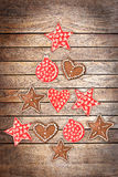 Ornaments on wood planks background creating the shape of a Christmas tree Stock Images