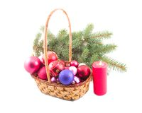 Ornaments in yellow basket. Ornaments from spheres in yellow basket at green branch Royalty Free Stock Images