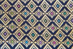 Ornamentu wzór na ścianie Tajlandzkiej nadokienny Lai Tajlandzki wzór Torby pamiątki od Tajlandia Projekt etniczna tekstura Wiosk Obraz Stock