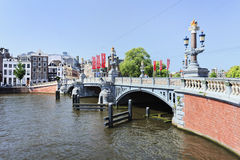 Ornate ancient bridge in Amsterdam Old Town. Stock Photos