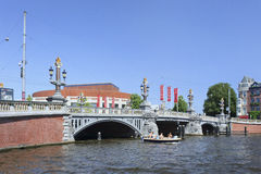 Ornate ancient bridge in Amsterdam Old Town. Stock Images