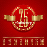 Ornate anniversary golden emblem Stock Image