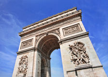 The ornate Arce de Triomphe against a blue sky, Paris, France. The wealthy ornate Arce de Triomphe against a blue sky, Paris, France Royalty Free Stock Photos
