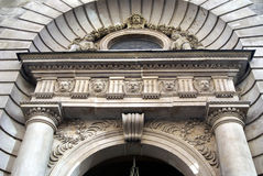 Ornate arched entrance with sculptures and columns Stock Images