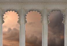 Ornate Arches with Sunset Cloud Scene. Three Ornate Marble Arches with Sunset Storm Cloud Scene behind royalty free stock photography