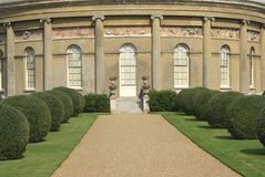 Ornate architecture. pathway and topiary Stock Photography