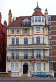 Ornate Victorian house on Kings Road, Brighton and Hove, Sussex, England. Ornate balconies on exterior of Victorian house on Kings Road, Brighton and Hove Royalty Free Stock Photo