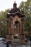 Ornate 1884 baroque-inspired Victorian Gothic sandstone water fountain now a traffic roundabout. Summer/Autumn scene from around Sydney, Australia royalty free stock photo
