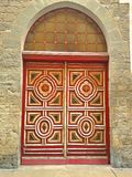 Ornate baroque red door. A gaily painted red wooden door Royalty Free Stock Photography