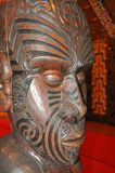 Carved interior of a Maori meeting house Stock Image