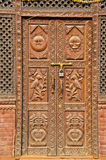 Ornate beautiful carved wooden door in asia Stock Photography