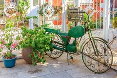 Ornate bicycle and potted plant on the streets of Gulangyu Islan Stock Image