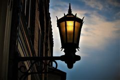 Ornate Black Lantern. An ornate black lantern on a town street Stock Image