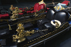 Ornate Black and Red Venetian Gondolas Venice Italy Stock Photography