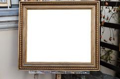 Ornate blank frame on the Easel in outside Art Gallery, White Is. Olated Clipping Path Royalty Free Stock Images