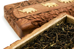 Ornate box with Darjeeling Tea. On a white background Stock Photography