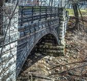 Ornate bridge in Park located in Milwaukee. Beautiful ornate bridge in local park Stock Image