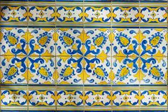 Ornate brightly colored Portugese tile texture in blue and yellow royalty free stock photography