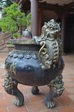 Ornate bronze handle on big urn stock image