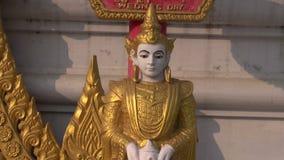 Ornate buddhists statue near temple, Kushinagar stock video