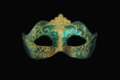 Ornate carnival mask. Ornate golden and turquoise carnival mask Royalty Free Stock Photo