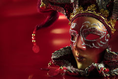 Ornate carnival mask. Over red textured  metallic background Stock Images