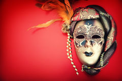 Ornate carnival mask over red background Stock Photos