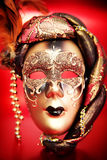 Ornate carnival mask over red background Stock Images