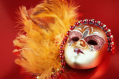 Ornate carnival mask on red background Royalty Free Stock Images