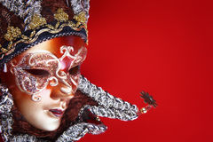 Ornate carnival mask on red background Royalty Free Stock Photos