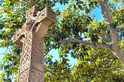 Ornate Carved Cross: At One with Nature Stock Photo