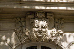 Ornate carved face at top of arch Royalty Free Stock Image