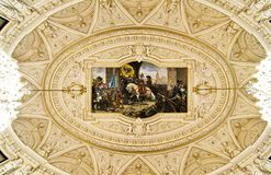 Ornate ceiling with fresco. And crystall glass chandeliers Stock Image